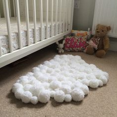 Pom-Pom Cloud Rug for Child's Bedroom DIY You can do this DIY without pom-pom makers, but I would recommend them, I ended up using 10 balls of yarn, yes, you'll need lots of that too, and this small rug consists of 116 pom-poms of varying sizes.  NOTE:I chose a chunky wool yarn, the chunkiness meant the pom-poms were quicker...