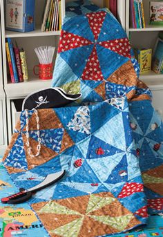 Delight your pirate-in-training and keep him warm at the same time with the Pirates Compass quilt by Jamie Wood.