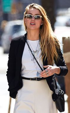 Amber Heard accessorized her effortlessly chic ensemble with layered necklaces, lotsa cool rings and off-white Clubmaster-inspired sunnies!