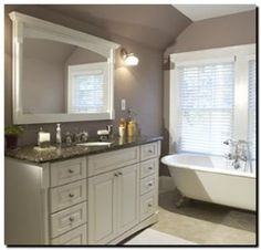 Love the grey and white...bathroom in question is smaller than this but could work..