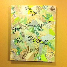 Super easy craft!  All you need is a canvas (any size), decorative paper, glue/modge podge, and a wall decal or stickers.  Tear up a ton of pieces from the decorative paper (whatever size you desire) and place them randomly all over the canvas, even the sides, with the glue.  You want to overlap the pieces to make it all flow.  Next, place the wall decal on (I cut out each individual word so that I could place the words as I wanted).  I finished it off with a coat of matte acrylic finishing…