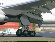 The 3-axle main gear is what sets a 777 apart from the rest.  Other Boeing planes (aside from the 747) only have 2-axles.