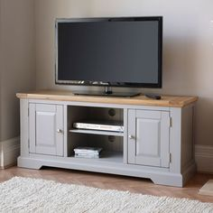 St Ives Natural Oak and Light Gray Painted Corner TV Stand unit furniture TV Stands Furniture, Oak Furniture, Oak Furniture Land, Oak Furnitureland, Television Cabinet, Light Gray Paint, Grey Tv Unit, Oak Tv Stand, Large Tv Cabinet