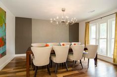 Contemporary dining room // Love these wide-backed, armless chairs and the multicolored hardwoods