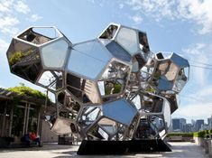 Artist Tomás Saraceno has created a constellation of large, interconnected modules constructed with transparent and reflective materials on the roof of the Metropolitan Museum of Art in New York. Visitors may enter and walk through the cluster of habitat-like, modular structures.