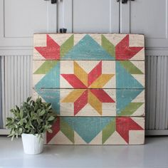 Image of Dutch Girl Barn Quilt - paint this design on top of end tables? A traditional looking Barn Quilt with a Tulip and Star pattern, finished for use indoors and out. Hobbies For 7 Year Olds Product Pinwheel in a Square Quilt Block Pattern 12 Camping Barn Quilt Designs, Barn Quilt Patterns, Star Patterns, Quilting Designs, Art Quilting, Block Patterns, Quilting Ideas, Barn Signs, Wood Signs