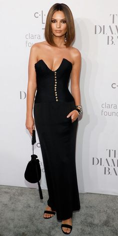 We can't get over Emily Ratajkowski at Rihanna's 3rd Annual Diamond Ball, wearing an ultra-sexy gown with a swooping neckline and gold button detailing. The model styled the dress to perfection with an elegant drawstring pouch (shop a similar style here), classic black heels, and not one but two gold and diamond cuffs by David Webb Jewels.