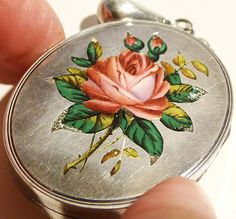 Antique Victorian silver and enamel rose locket • http://www.ebay.com/itm/Antique-VICTORIAN-SILVER-ENAMEL-ROSE-LOCKET-COLLAR-NECKLACE-/350534539413?pt=UK_Jewellery_Watches_VintageFineJewellery_CA&hash=item519d7c9895#ht_4714wt_1165