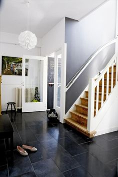 Love it all, especially the wood stairs against the dark floors and walls