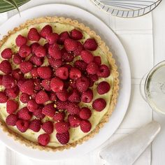 Raspberry Tart with a Pistachio Crust |Pastry chef Jennifer McCoy often brings this raspberry tart, with its creamy filling and pistachio-studded crust, to dinner parties. She packs the components separately and assembles the tart just before serving. Food & Wine