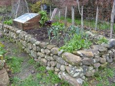 Raised bed with rocks.  much better match to the saltbox