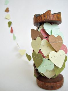 i kind of love this garland of hearts - you could make something like this yourself if you go to michael's crafts and get scrapbooking paper and a heart cutout and string.