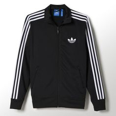 From Olympic podiums to concert stages, the adidas Originals Firebird Track Top has been almost everywhere and done almost everything. Now it's your turn to zip up this iconic men's track jacket and expand the legacy. Adidas Zip Up, Adidas Men, Adidas Jacket Mens, Fashion Wear, Look Fashion, Camisa Adidas, Casual Outfits, Cute Outfits, Tracksuit Set