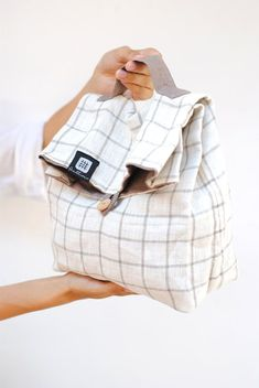 Natural linen fabric bag with a small wooden button and a handle stripe  will be keeping 8d02d0da3f