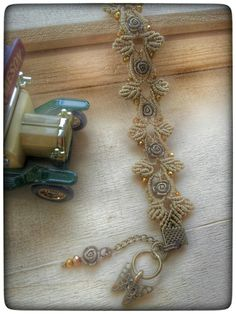 macrame bracelet with metal objects                              …                                                                                                                                                                                 More