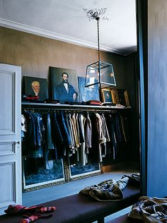 dressing room/closet love the art work on the shelves for the master closet