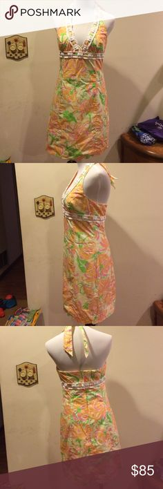 Lilly Pulitzer halter dress size 6 Lilly Pulitzer halter dress size 6.  Gorgeous yellow background with orange and pjnk flowers.  Truly gorgeous.  White bric a brac with beading.  100 % cotton fully lined. Lilly Pulitzer Dresses