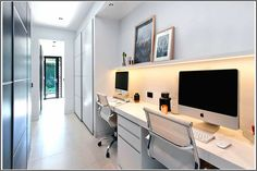 With enough room for two, this large desk sits below a small floating shelf with hidden lighting, while the long white hallway provides the perfect space for a tucked-away home office. Study Room Design, Study Nook, Office Space Design, Small Room Design, Home Office Space, Home Office Decor, Study Space, Office Ideas, Modern Architecture Design
