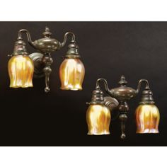 Tiffany Studios, pair of two light Tulip sconces, patinated bronze and favrile glass, circa 1900
