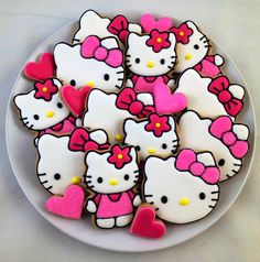 This listing includes 16 x custom cookies. 6 x Hello Kitty Head Cookies 6 x Full Body Hello Kitty Cookies 4 x Mini Heart Cookies  All cookies can be