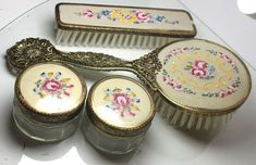 Very pretty set with cream fabric backs decorated with colorful embroidered flowers under plastic covers. Both brushes are solidly made with nylon bristles set into wooden bases. Dresser Sets, Vintage Vanity, Vanity Set, Embroidered Flowers, Vintage Silver, Pink And Gold, Brushes, Vintage Antiques, Jars