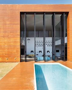 Height Project - Guilherme Torres. How the height of the doors and simple quirky art work add to the drama.  Pale blue pool tiles and pale blue ottoman....!