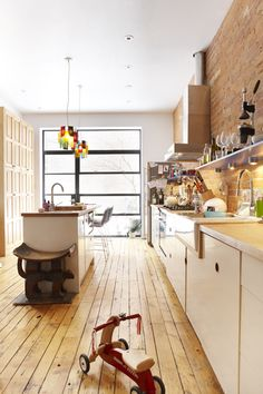 blown out back wall? - doing it! exposed brick wall? - got it! This is the closest inspiration pic I've found to what our kitchen will look like in my dreams