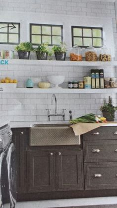 Kitchen or laundry shelves. Love backsplash