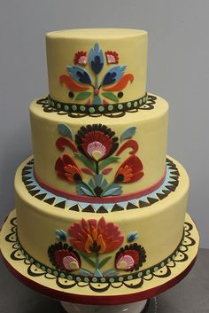 Folk Art Wedding cake, via Alliance Bakery. Interesting idea. I would change the colors.