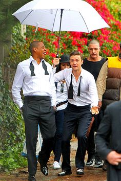 """Jay Z and Justin Timberlake Pals Justin Timberlake and Jay Z got caught in the rain on set of their music video for """"Suit & Tie"""" in Los Angeles in January 2013. Matching in black and white, Timberlake covered the two with an umbrella while making the rapper crack a smile."""