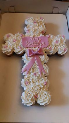 Bare Cakery, Beloit, WI. Baby dedication cake. Pink bow. Pull apart cupcakes. Rosettes. Fondant. Cross.
