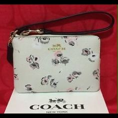 """SALE! NWT Coach flowered wristlet SALE!!! NWT Coach gorgeous flowered wristlet!!!! SOooooooo beautiful & perfect for spring!!! Measures 6 1/2"""" in length & 4"""" in height Coach Bags"""