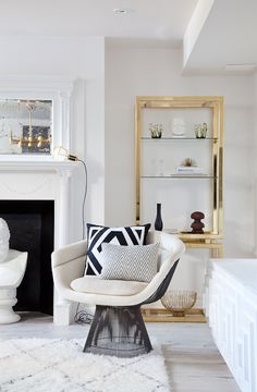 White molded fireplace and brass shelves