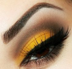 Yellow and brown make up for brown eyes. Love this look and its so simple! It reminds me of a monarch butterfly. Love!