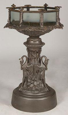 American Victorian Fiske cast iron aquarium having octagonal glass paneled tank circa 1890