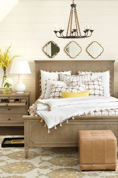 Bedroom featuring Isabella Collection, neutral bedding, and yellow accents