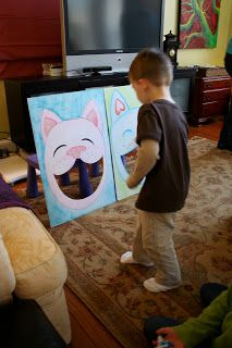 """Toss a bone into a dog's mouth - From """"Birthday Party Highlights: Pink Kitty 4th Birthday Party!"""""""