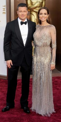 Brad Pitt and Angelina Jolie's Cutest Couple Moments - At the Oscars, 2014 from #InStyle