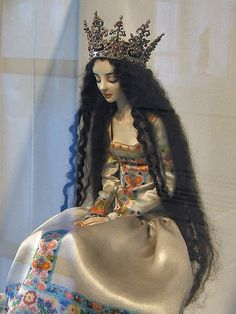 Sleeping beauty, a dollmaker's talented artistry virtually gives life to an inanimate object.