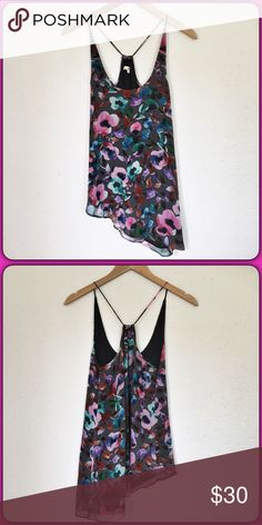 """LAMade Tank Top Beautiful LAMade tank top in excellent condition.  Features an all over floral print in vibrant colors with an asymmetrical hem.  Top is completely lined. Material is 100% silk.  Measurements laid flat: bust 16"""", length from top of shoulder to shortest part of hem 24 1/2"""" and longest 30 1/2"""". LAmade Tops Tank Tops"""