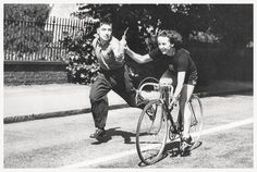 Eileen taking a drink at speed from husband Ken. Check out the deep drop of her handlebars. No riding on the hoods for her. Eileen was legendary during the 1940-1950's, winning every major amateur championship available to her. She won the women's B.B.A.R. in 1949 and '50. On turning professional with the Hercules bicycle maker she broke every place-to-place road record from 25 to 1000 miles! Wonder Wheels? . . . Wonder Woman!