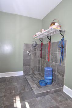 Mud room with dog bath. More
