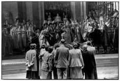 """Louvre Museum. 1954. Visitors looking at """"The Coronation of Napoleon"""" by Jacques-Louis David. (by Henri Cartier-Bresson)"""