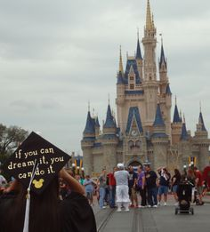 """I took my UCF graduation pictures in Magic Kingdom at Walt Disney World. On my graduation cap, I wrote Walt Disney's quote, """"If you can dream it, you can do it."""" And of course I added Mickey Mouse :) #Disney #Graduation #UCF"""