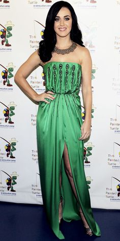 Perry celebrated Carole King in a green YSL column. A statement necklace and ankle-strap heels completed the look.