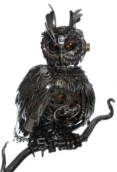 Steampunk Tendencies | Steampunk Eagle Owl made from cutlery, motorbike, and bicycle parts. Mounted on driftwood and forged steel branch. By Alan Williams https://www.facebook.com/groups/steampunktendencies/permalink/672856662768773/ — with Alan Williams.