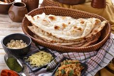 indian naan bread with some ingredients of indian food by odua. full portrait of indian naan bread with some ingredients of indian food Egg Recipes, Indian Food Recipes, Bread Recipes, Ethnic Recipes, How To Make Naan, Garlic Naan, Naan Recipe, Types Of Bread, Chapati