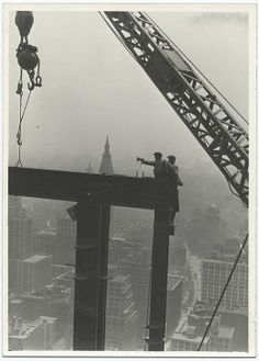 1931 Two construction workers at the corner of two steel beams point to left while constructing the Empire State building. This year marks the anniversary of the Empire State building. The Empire State building was the world's tallest building from Empire State Building, Old Pictures, Old Photos, Vintage Photos, Vintage Photographs, Construction Safety, Construction Worker, Tom Of Finland, World Trade Center