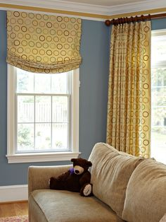 it is perfectly okay to mix window treatment styles in one room, If it is united by fabric.
