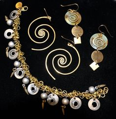 Lochlin Smith of Vermont creates his jewelry in bronze and finishes it with a variety of materials including antique silver and colored patinas. Surface treatments are achieved using torching and hammering techniques. His hand-forged jewelry include spiral motifs and freestyle glyph-like shapes. Chains, earwires, and all materials are of the highest quality available. Smith's line of jewelry is available in the Currier Museum of Art's Museum Shop in Manchester, NH; prices start at $35.